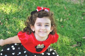 girl smiling in mickey mouse