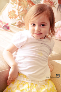 Little lgirl wearing yellow skirt and white top