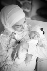 newborn with mommy in black and white